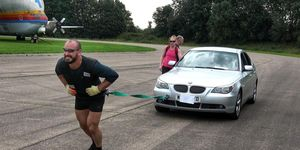 Man pulls car for a marathon
