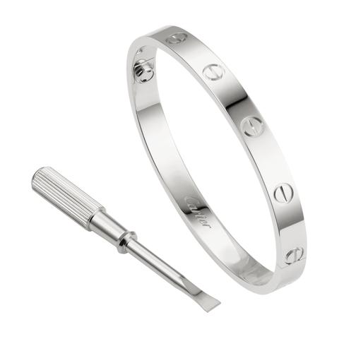 Platinum, Metal, Fashion accessory, Jewellery, Ring, Silver, Wedding ring, Titanium, Wedding ceremony supply, Mineral,