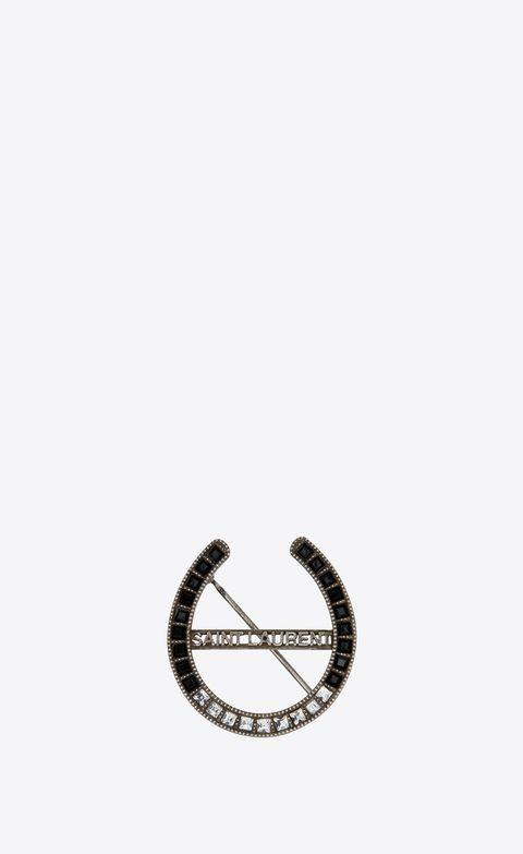 Font, Horseshoe, Fashion accessory, Symbol, Games, Metal,