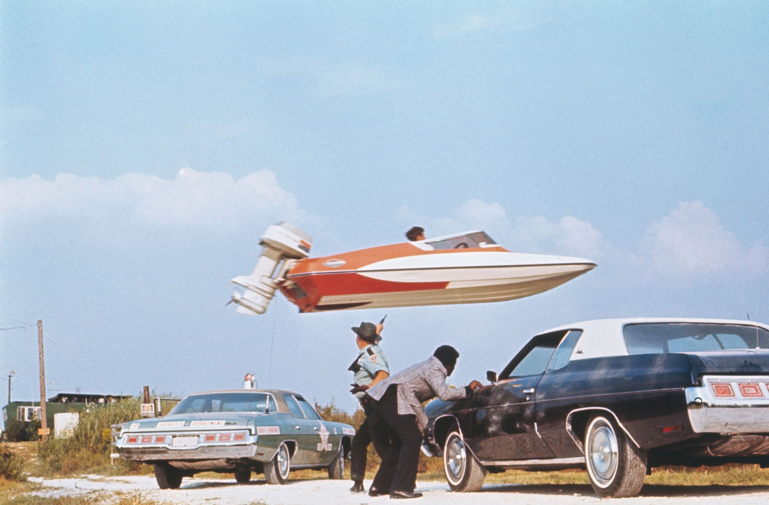 Stunt performer Jerry Comeaux jumps a Glaston GT-50 speedboat over police officers and their squads as part of an escape scene from Live and Let Die.