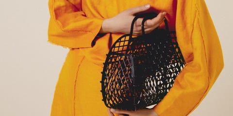 Yellow, Clothing, Orange, Shoulder, Bag, Joint, Fashion, Handbag, Fashion accessory, Costume,
