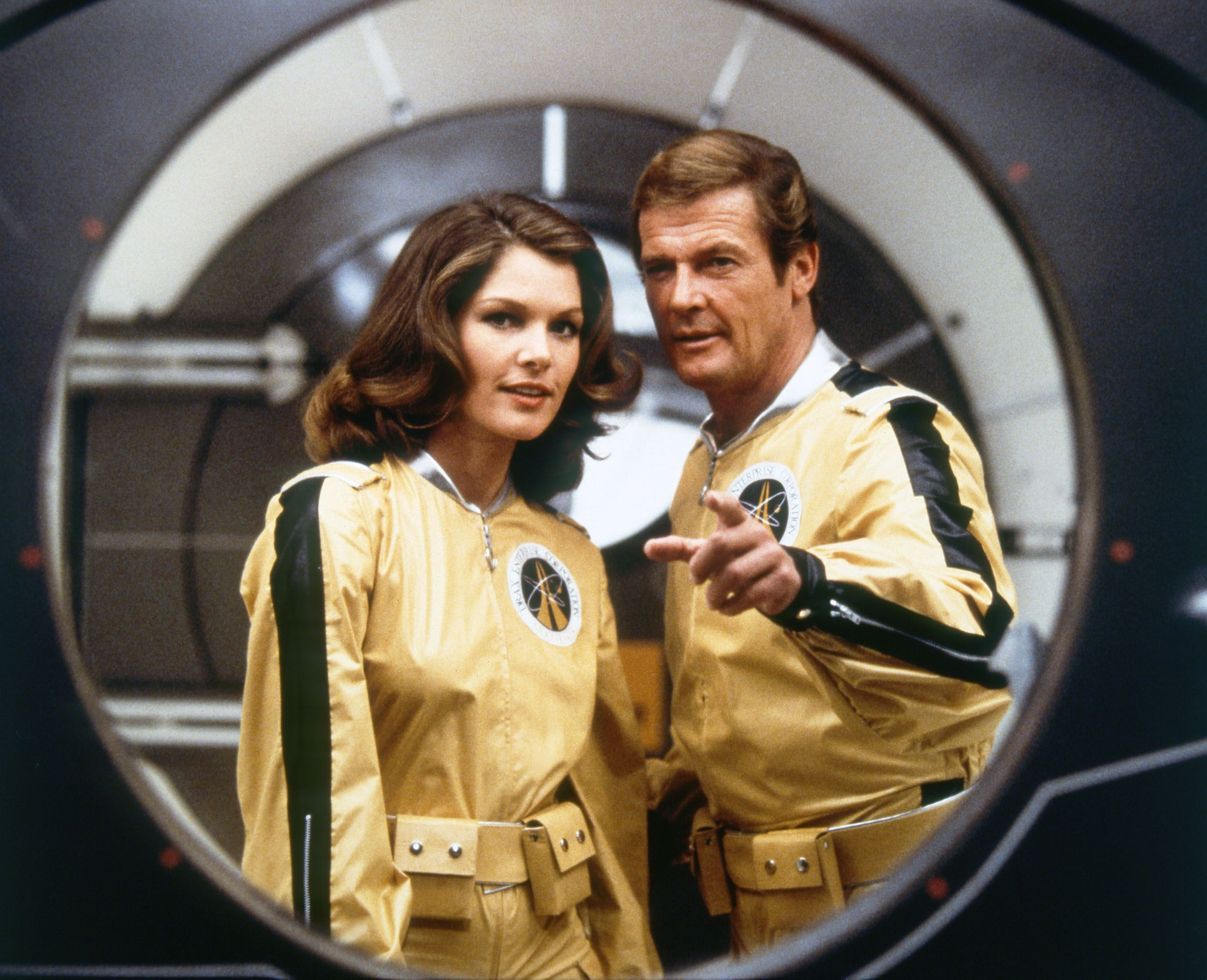 Roger Moore and actress Lois Chiles on the set of Moonraker.