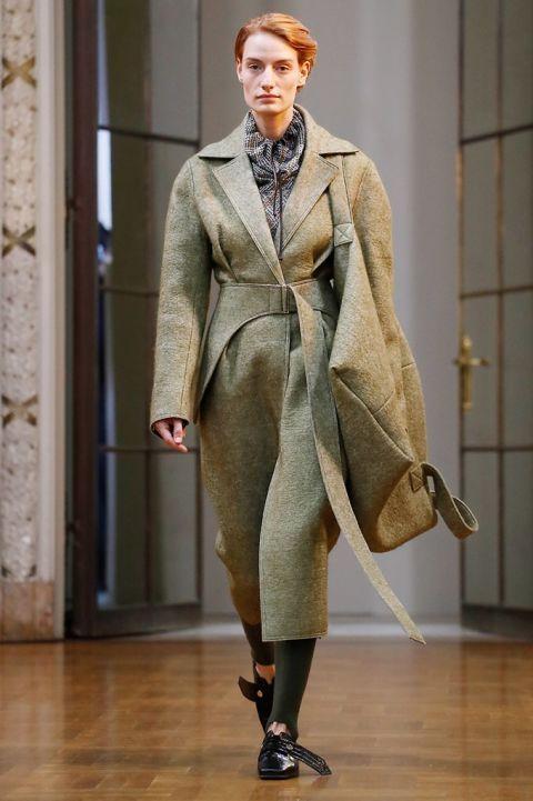 Fashion, Clothing, Fashion model, Runway, Fashion show, Overcoat, Coat, Outerwear, Haute couture, Beige,