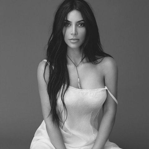 White, Clothing, Model, Sitting, Photo shoot, Beauty, Leg, Black-and-white, Lip, Long hair,