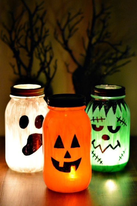 Mason jar, Orange, Lighting, Lantern, Pumpkin, Candy corn, Home accessories, Drinkware, Jack-o'-lantern, Plant,