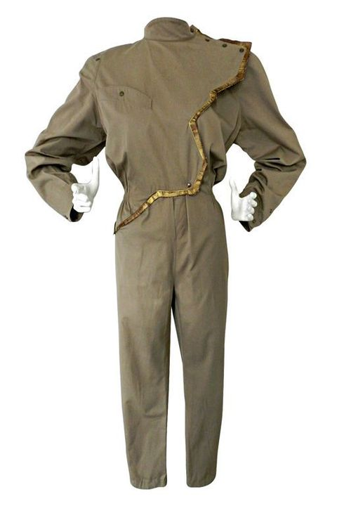Clothing, Suit, Outerwear, Khaki, Standing, Sleeve, Jacket, Rain suit, Trousers, Formal wear,