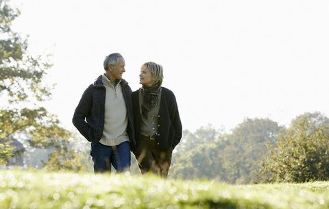 An older couple, walking