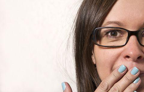 woman hiding mouth