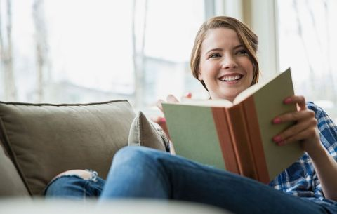 woman reading and smiling