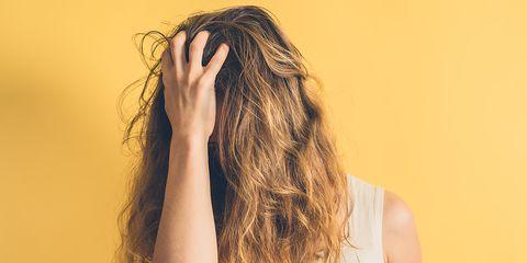 woman shaking hair