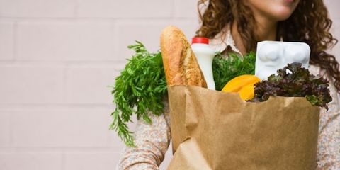 fruits and veggies might boost mood; woman with grocery bag