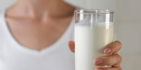 Dairy foods can assist fat-burning for weight loss; woman with milk