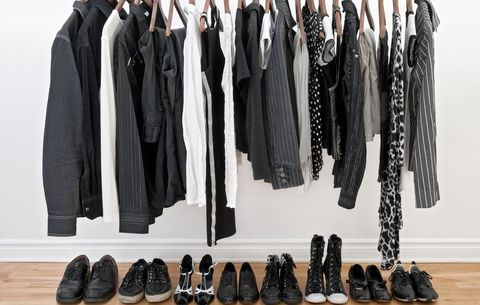 Organized hall closet with clothing and shoes