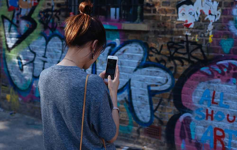5 Moves That Un-Hunch Your Neck From All That Time Spent Looking Down At Your Phone