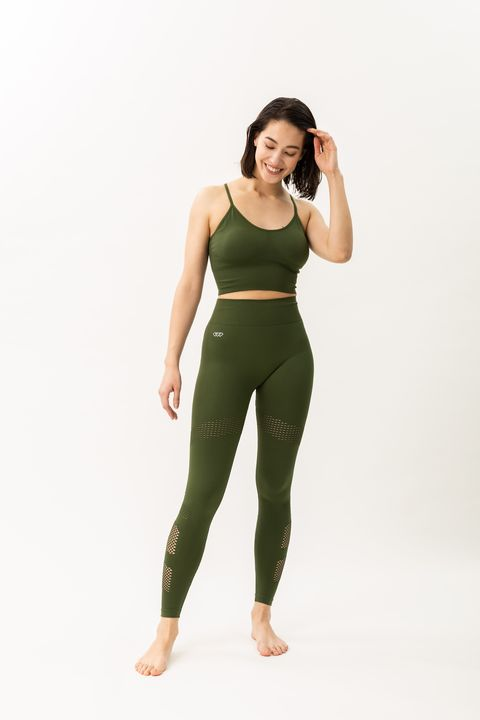Clothing, Green, Shoulder, Sportswear, Standing, Waist, Arm, Tights, Leggings, Joint,