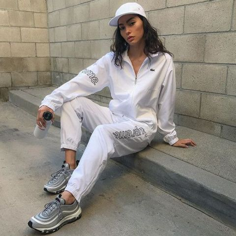 White, Clothing, Street fashion, Cool, Fashion, Cap, Footwear, Jeans, Sleeve, Headgear,