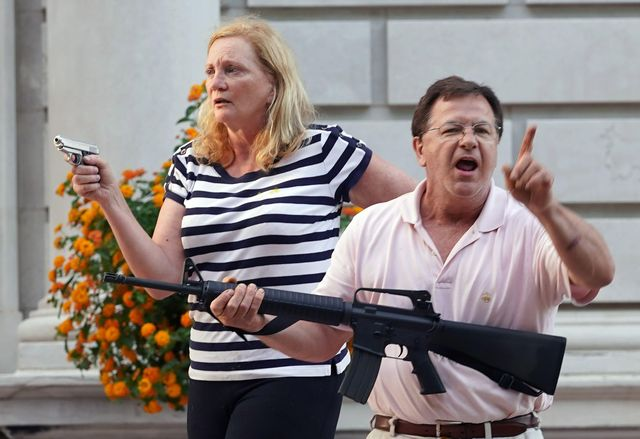 patricia mccloskey and husband mark, shown aiming their guns at black lives matter protesters in st louis in june 2020