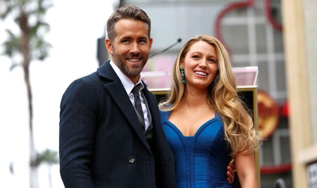 2cjwc8g actor ryan reynolds poses with his wife blake lively after unveiling his star on the hollywood walk of fame in hollywood, california us, december 15, 2016   reutersmario anzuoni