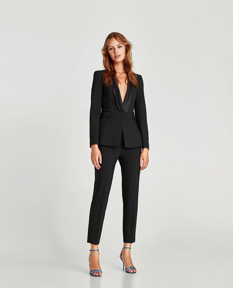 Clothing, Suit, Blazer, Outerwear, Formal wear, Jacket, Standing, Sleeve, Neck, Tuxedo,