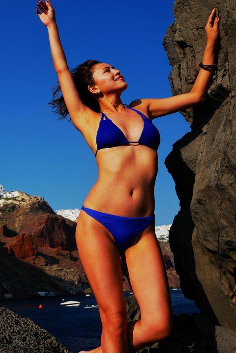 Bikini, Photograph, Blue, Beauty, Clothing, Model, Swimwear, Beach, Photo shoot, Muscle,