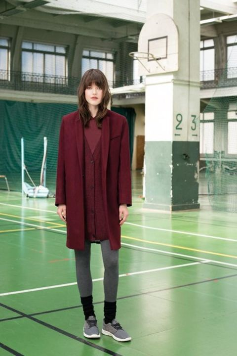 Sleeve, Collar, Standing, Flooring, Street fashion, Hall, Fashion design, Overcoat, Scarf, Aircraft,