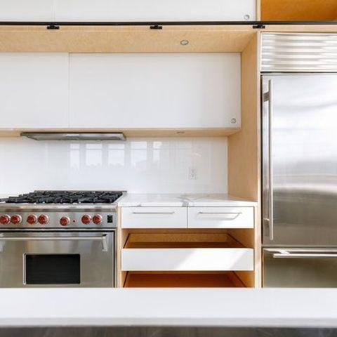 Room, Kitchen, Kitchen stove, Furniture, Property, Countertop, Kitchen appliance, Orange, Home appliance, Major appliance,