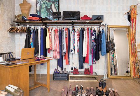 Room, Closet, Furniture, Shelf, Boutique, Clothes hanger, Textile, Wardrobe, Shelving, Building,