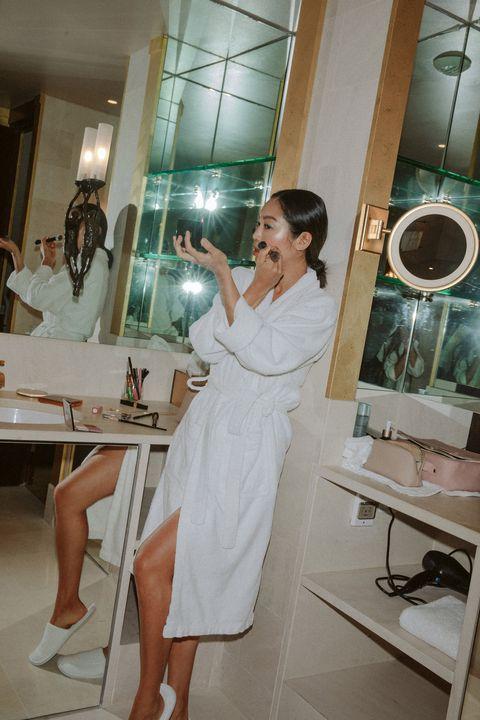 Shoulder, Dress, Leg, Room, Fashion design, Black hair, Long hair, Gown, Interior design, Mirror,