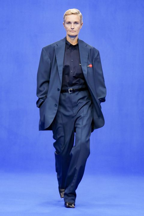 Fashion, Runway, Fashion show, Suit, Human, Formal wear, Fashion design, Event, Haute couture, Outerwear,