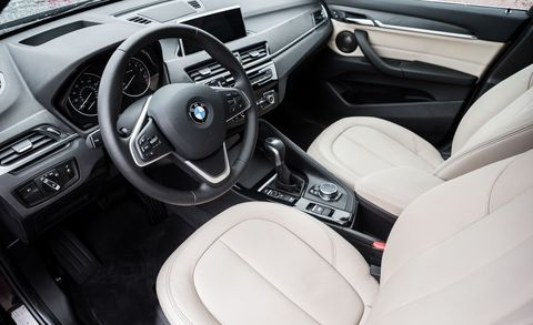 Land vehicle, Vehicle, Car, Center console, Steering wheel, Personal luxury car, Bmw, Car seat, Luxury vehicle, Family car,