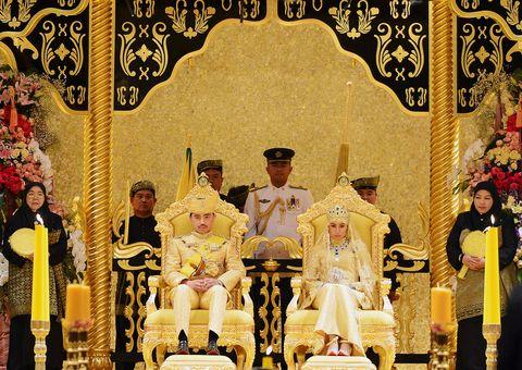 "brunei's newly wed royal couple, prince abdul malik and dayangku raabi'atul 'adawiyyah pengiran haji bolkiah, sit during the ""bersanding"" or enthronement ceremony at their wedding in the nurul iman palace in bandar seri begawan april 12, 2015 malik is the son of brunei's sultan hassanal bolkiah, one of the world's richest men reutersahim rani"