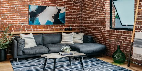 Brick, Brickwork, Wall, Living room, Room, Blue, Furniture, Property, Interior design, Home,