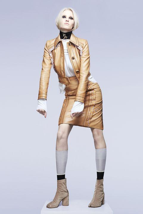 Joint, Fashion, Standing, Shoulder, Fashion design, Beige, Footwear, Figurine, Outerwear, Costume design,