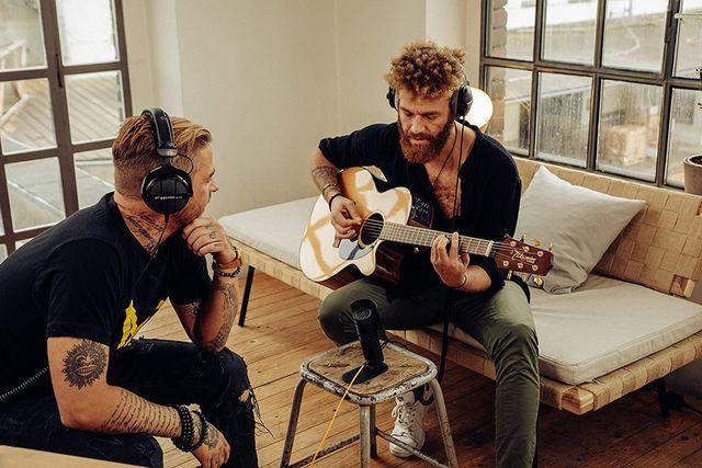 two men using beyerdynamic headphones