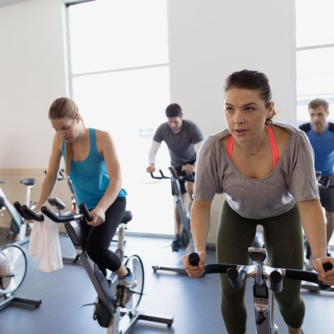 Stationary bicycle, Gym, Indoor cycling, Exercise machine, Physical fitness, Fitness professional, Room, Exercise, Exercise equipment, Sports,