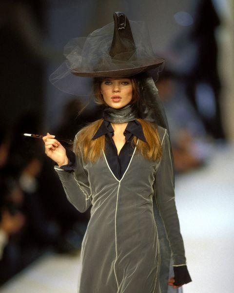 Fashion, Clothing, Fashion model, Fashion show, Runway, Fashion design, Hat, Outerwear, Event, Long hair,