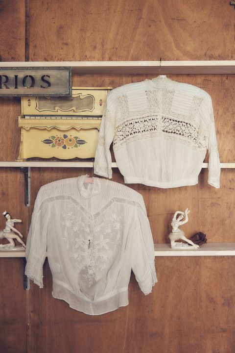 White, Clothing, Clothes hanger, Shirt, T-shirt, Top, Sleeve, Room, Textile, Beige,