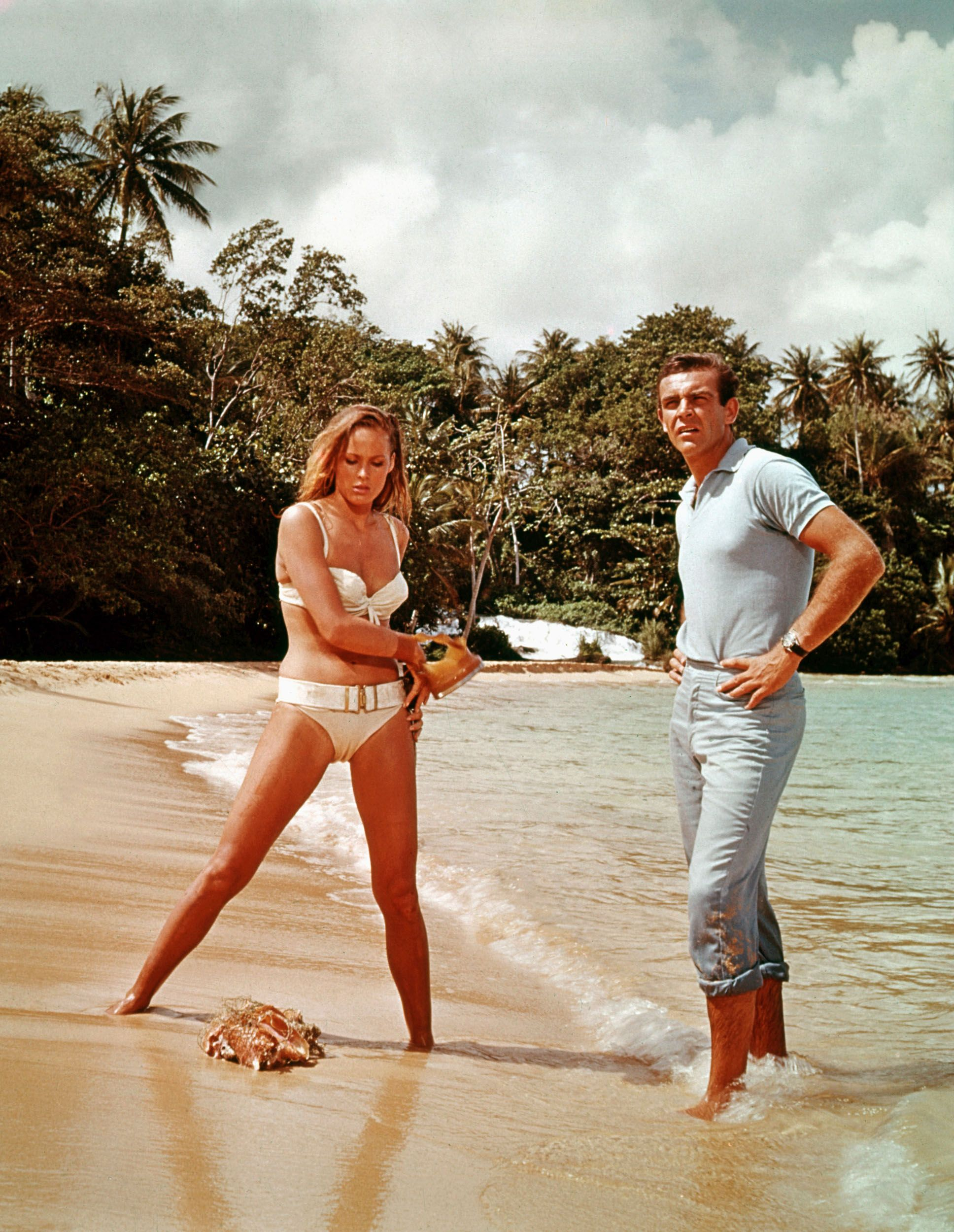 Ursula Andress and Sean Connery on the shore in a scene from Dr. No.