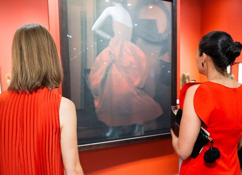 Red, Fashion, Dress, Tourist attraction, Room, Event, Photography, Interior design, Reflection, Art exhibition,