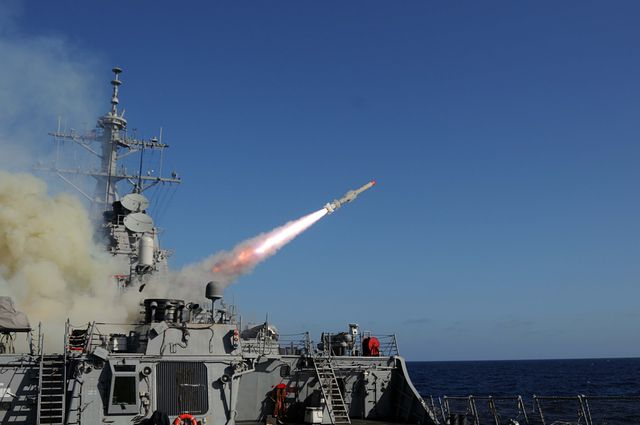 the guided missile destroyer uss mitscher launches a harpoon anti ship missile at the ex usns saturn during a sinking exercise mitscher and other ships assigned to the george hw bush carrier strike group fired live ammunition at saturn
