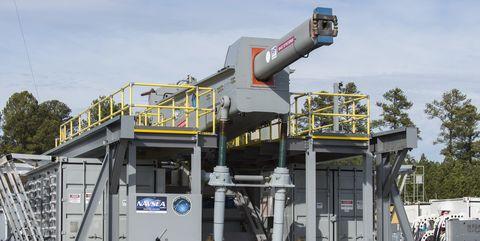 Transport, Vehicle, Architecture, Tree, Construction equipment, Crane, Roof, Plant, House, Building,