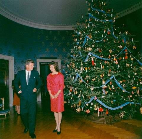this photograph by white house photographer robert knudsen shows president john f kennedy and first lady jacqueline kennedy in front of the blue room christmas tree this photograph was taken in 1961 before the extensive renovations initiated by the first lady