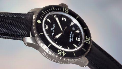 Watch, Analog watch, Watch accessory, Strap, Fashion accessory, Jewellery, Material property, Brand, Hardware accessory, Metal,