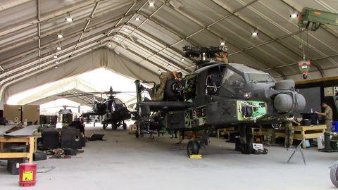 Vehicle, Aerospace engineering, Helicopter, Hangar, Rotorcraft, Aircraft, Engine, Auto part, Automotive engine part, Military helicopter,