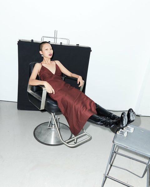 Chair, Furniture, Sitting, Leg, Shoulder, Photo shoot, Dress, Photography, Folding chair, Style,