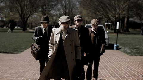 People, Standing, Coat, Trench coat, Headgear, Suit, White-collar worker, Street, Hat, Vintage clothing,