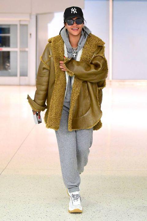 Clothing, Fashion, Street fashion, Outerwear, Coat, Fashion show, Footwear, Human, Fashion model, Fur,
