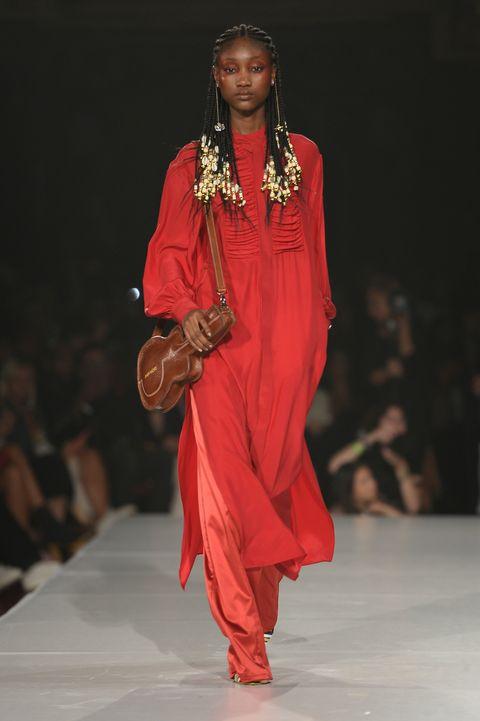 Fashion model, Fashion, Fashion show, Runway, Clothing, Fashion design, Formal wear, Event, Shoulder, Dress,