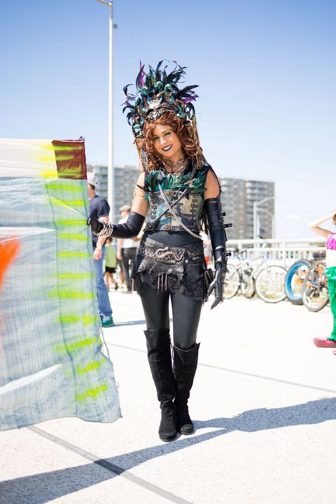 Textile, Jacket, Street fashion, Bicycle wheel, Boot, Bicycle tire, Headpiece, Waist, Leather jacket, Leather,