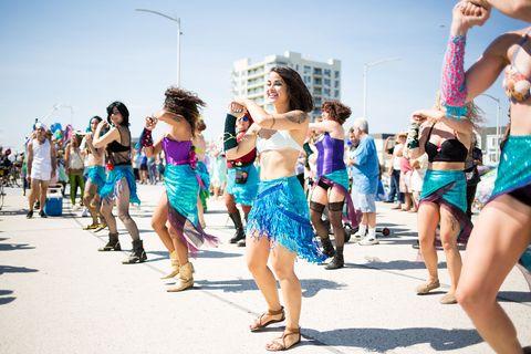Footwear, Leg, Event, Entertainment, Performing arts, Human leg, Summer, Musical instrument, Thigh, Dancer,